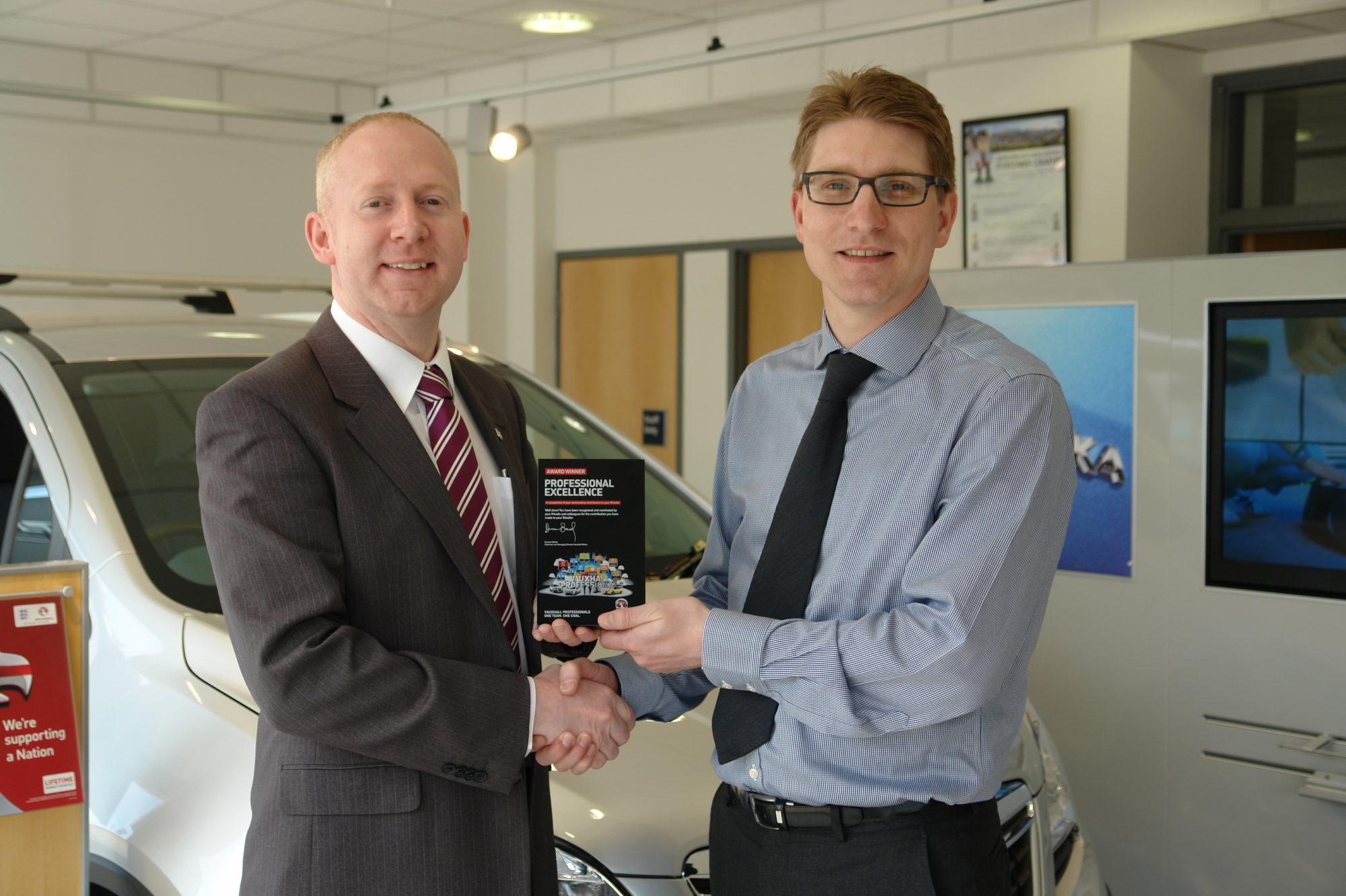 Dean Matthews receiving his Vauxhall award from Matthew Piper